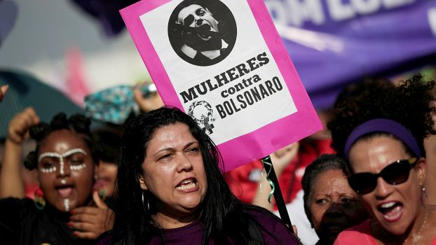 "A woman holds a sign that reads ""Women against Bolsonaro"" during demonstrations against presidential candidate Jair Bolsonaro in Brasilia, Brazil September 29, 2018. REUTERS/Adriano Machado -"